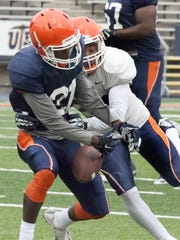 UTEP wide receiver Eddie Sinegal, left, gets the ball stripped by defensive back Dashone Smith during Saturday's scrimmage in Sun Bowl Stadium.