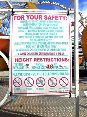 This sign posted on the Rok N Rol ride at the Elizabethtown Fair on Sunday, Aug. 21, commands riders to follow height requirements and safety instructions. Experts said failure to comply with posted rules is one of the main causes of serious injury on amusement rides.