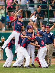 The Maine-Endwell little league team celebrates its 2-1 win over East Seoul for Little League World Series Championship in Williamsport, PA, on Sunday, August 28.