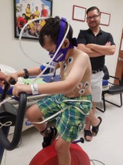 Colin undergoes performance testing in June 6th at St. Jude Children's Research Hospital in Memphis as his father Ian Hayward watches.