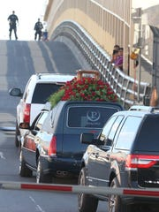 The hearse containing the remains of Mexican singer/songwriter Juan Gabriel crosses the Stanton Street Bridge on its way to Juarez, where a number of memorial events will take place.