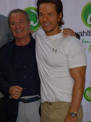 Birmingham Bella Piatti owner and Wahlburgers managing partner Nino Cutraro greeted fans on the red carpet with Wahlburgers founder and movie star Mark Wahlberg.