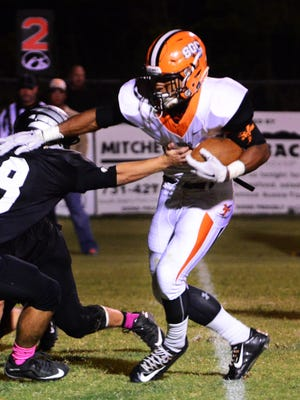 Tyler Dysart attempts to break avoid a tackle from South Side's Hunter Ross during South Gibson's game there last year.