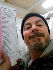 Bill Phillips takes a selfie with his marked election ballot. The secrecy of the voting booth may soon be a thing of the past.