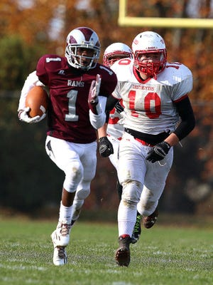 South River Travis Thomas is chased by Dunellen's Joe Olsommer in the first half of Saturday's game.