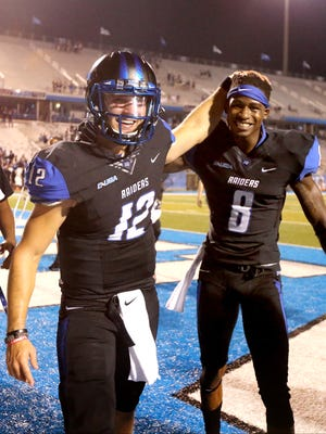 MTSU quarterback Brent Stockstill (12) has been an influence on senior cornerback Jeremy Cutrer (8). Both receive their bachelor degrees on Saturday.