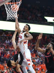 Clemson forward Jaron Blossomgame (5) is fouled by Georgia guard J.J. Frazier (30) during the 2nd half on Friday, November 11,  2016 at Clemson's Littlejohn Coliseum