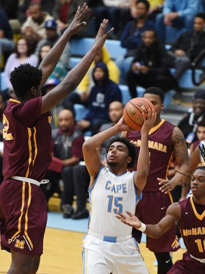 Cape Henlopen's William Yeates shoots for 2 points past Bishop McNamara's Makhi Mitchell in a previous Slam Dunk to the Beach at Cape Henlopen High School near Lewes.