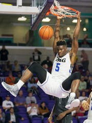 IMG Academy's Emmitt Williams scores against Norcross during the Culligan City of Palms Classic at the Suncoast Credit Union Arena in Fort Myers in December.