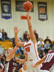 Washington's Maham Shah (40) goes up for a shot during a rescheduled Edith Sanford Breast Center Girls Pentagon Classic game against Crofton Thursday, Dec. 29, 2016, at Washington High School in Sioux Falls.