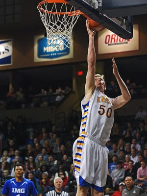 O'Gorman's JP Costello (50) goes up for a shot during the Gary Munsen Tournament Championship game against IMG Academy Friday, Dec. 30, 2016, at the Sanford Pentagon in Sioux Falls.
