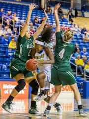Delaware's Nicole Enabosi tries to cut to the basket between William & Mary's Chandler Smith (left) and Jeanne Gaumont (right) in the first half of Delaware's 60-49 loss to the College of William & Mary at the Bob Carpenter Center in Newark on Monday afternoon.