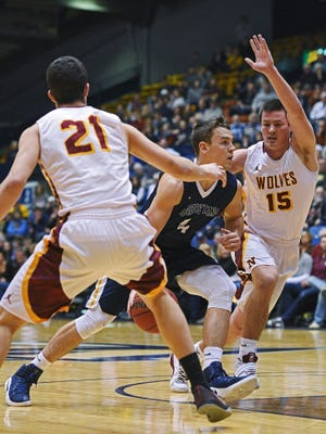 Augustana's Mike Busack (4) drives between Northern State's Gabe King (21) and Bo Fries (15) during a game Saturday, Jan. 14, 2017, at the Sioux Falls Arena in Sioux Falls.
