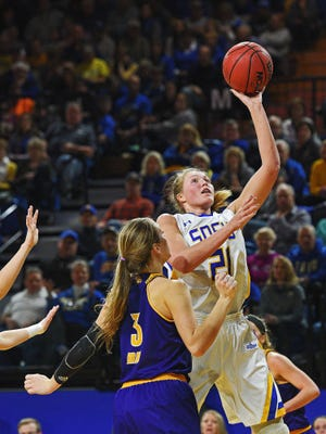 SDSU's Clarissa Ober (21) goes up for a shot over Western Illinois' Olivia Braun (3) during a game Saturday, Jan. 21, 2017, at Frost Arena on the South Dakota State University campus in Brookings, S.D.