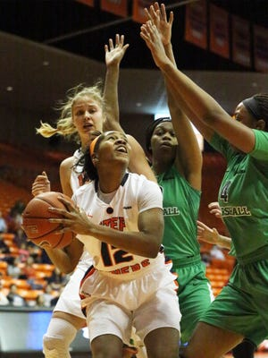 UTEP's Sparkle Taylor, 12, looks for a way to get a shot up against Marshall earlier this year. The Miners face North Texas on Thursday night.