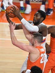 Clemson forward Elijah Thomas (14) pulls down a rebound over Syracuse forward Tyler Lydon (20) during the 1st half on Tuesday, February 7,  2017 at Clemson's Littlejohn Coliseum.