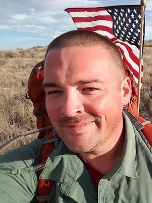 "Eli Smith is walking a 13,000-mile ""lap around the U.S."" to call attention to military veterans who are suffering from PTSD. He started in November what he believes will be a four-year journey from Pensacola, Florida. He reached Las Cruces on Wednesday."
