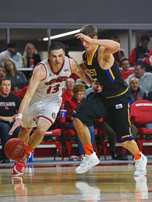 USD's Matt Mooney (13) drives past SDSU's Lane Severyn (25) during a game Saturday, Feb. 11, 2017, at the Sanford Coyote Sports Center on the University of South Dakota campus in Vermillion, S.D. USD beat SDSU 91-89.