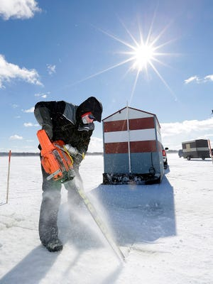 Brad Teichmiller of Fond du Lac cuts a hole in the ice for Foot of the Lake fishing club members Friday morning for the start of the 2016 sturgeon spearing season.  Sturgeon spearing begins Feb. 10 on Lake Winnebago and the Upland Rivers in Northeast Wisconsin.