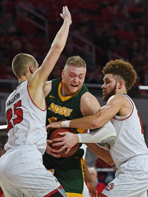 NDSU's Dexter Werner (40) tries to get between USD's Tyler Hagedorn (25) and Trey Burch-Manning (12) during a game Wednesday, Jan. 11, 2017, at the USD Sanford Coyote Sports Center in Vermillion, S.D.