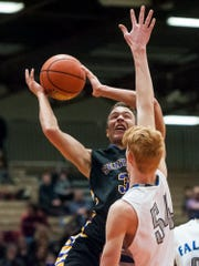 Billings Skyview's Zach Schacht rises to block a Missoula Sentinel shot.