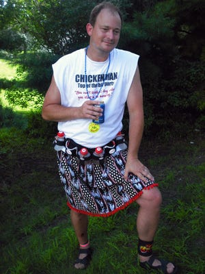 "Mark Chelgren in this file photo is shown prior to his 2010 election to the Iowa Senate relaxing in his ""Chickenman"" persona on The Register's Annual Great Bicycle Ride Across Iowa."