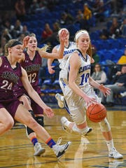 St. Thomas More's Dru Gylten (10) dribbles past Madison's Olivia Rud (24) and Jessi Giles (12) during a 2017 SDHSAA Class A State Girls Basketball Tournament quarterfinal game Thursday, March 9, 2017, at Frost Arena on the South Dakota State University campus in Brookings, S.D. St. Thomas More beat Madison 57-32.