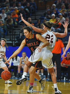 Jayda Knuppe (42) tries to get past Lennox's Courtney Weeldreyer (22) during the 2017 Class A State Girls Basketball Tournament quarterfinal game in Brookings. The Quarriers missed the tournament last year, but are eyeing another potential run.