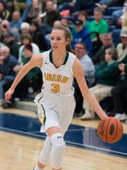 York Catholic's Abigail Pilkey (3) dribbles down the court during the first-round tournament match-up of the PIAA Class 3A between York Catholic and Loyalsock on Saturday, March 11, 2017 at West York High School.