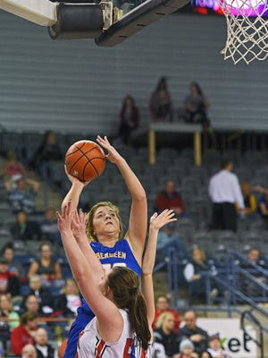 Aberdeen Central's Paiton Burckhard (33) goes up for a shot over Brandon Valley's Lexi Ellingson (50) during a 2017 SDHSAA Class AA State Girls Basketball quarterfinal game Thursday, March 16, 2017, at Rushmore Plaza Civic Center in Rapid City.