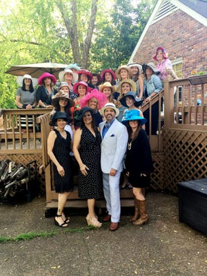 Hosts Keith and Sarah Solsvig (front and center) are surrounded by some of their hat-adorned guests at their annual Kentucky Derby party hosted at their Cottonwood home.