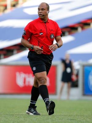 Match official Brandon Artis, works the Lamar Hunt US Open Cup game between Louisville City FC and FC Cincinnati, Wednesday, May 31, 2017, at Nippert Stadium in Cincinnati.