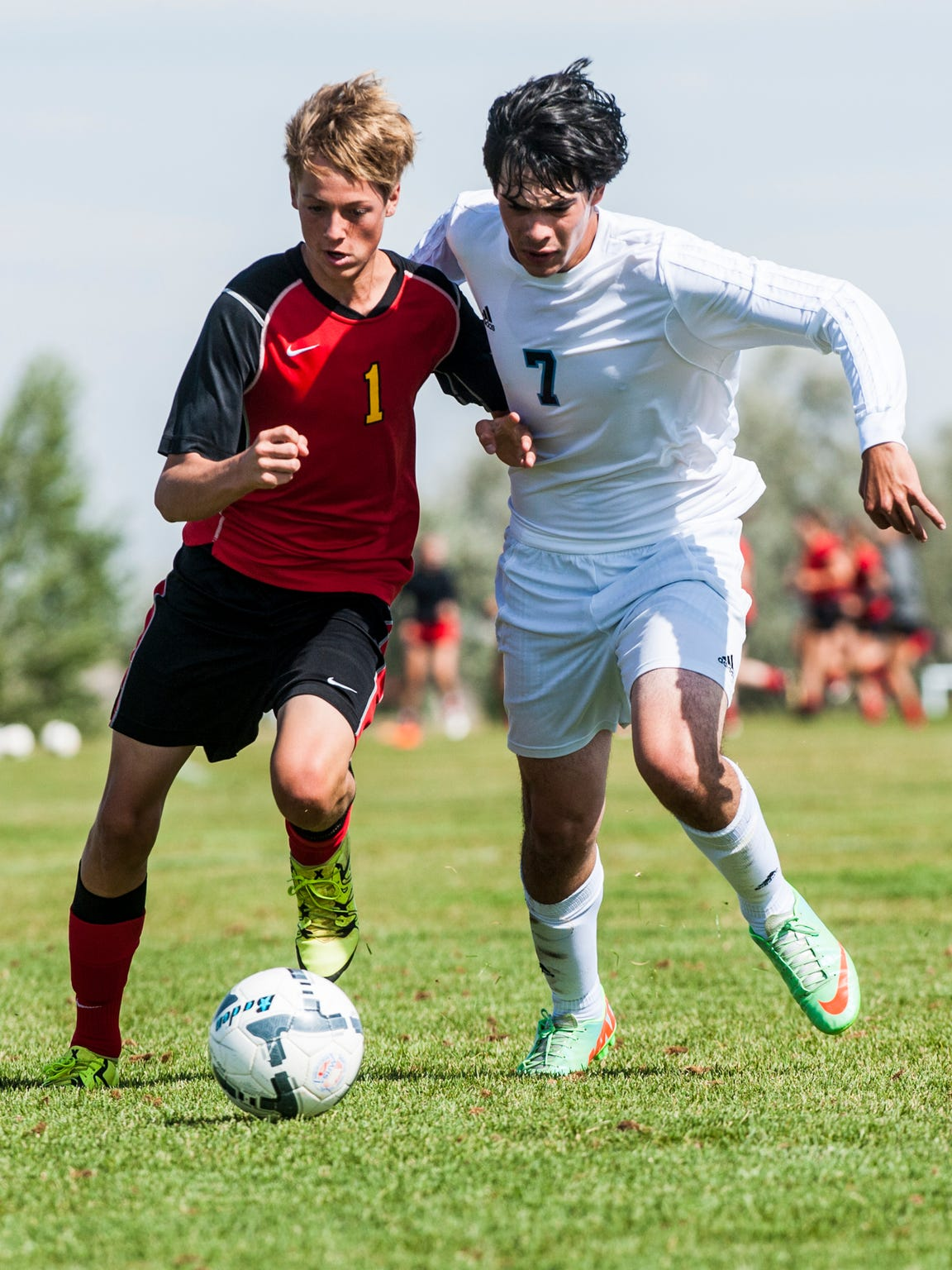 Great Falls' Israel Bonilla battles Missoula Hellgate's Campbell Rolston-Clemmer during the Soccer Jamboree at Siebel Soccer Complex Saturday.
