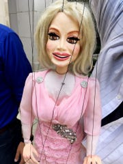 """The Dolly Parton puppet is a favorite in """"String City."""""""