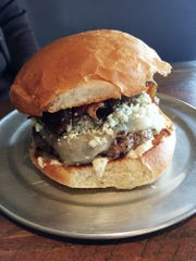 The signature Stout Burger is chock full of blue cheese