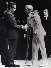 John McCain is greeted by President Richard Nixon (left)