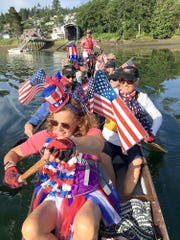 The Gig Harbor Dragons head out into the harbor festooned in their finest red, white and blue.