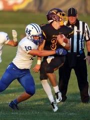 Cooper QB Michael Armor gets tackled for a loss by