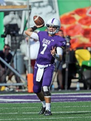 Elder quarterback Danny Nieman attempts a pass in the