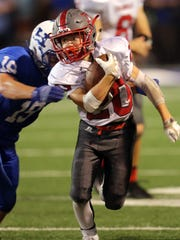 Dixie Heights running back A.J. Dilts runs for a first down in the game between the Dixie Heights Colonels and the Highlands Bluebirds at Highlands High School.