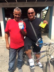 Two men in Catano, Puerto Rico, holding boxes of bandages