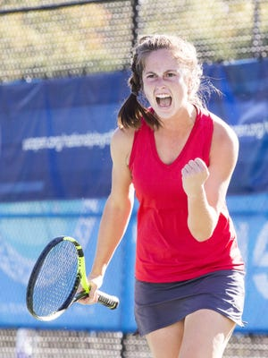 """Vineland's Tess Fisher screams her signature """"Come on!"""" as she wins the third game in her first set against Holy Angel's Ashley Hess (not pictured) in the NJSIAA Singles Tournament Final on October 21. Prior to this game, Hess was undefeated in her season and Fisher had won second place in the NJSIAA Singles Tournament Final in 2015."""