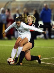 Loveland striker Brice Grieshop tangles with Olentangy