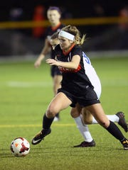 Loveland striker Brooke Harden goes on the attack in the semi final match between Loveland and Olentangy Liberty High School in Centerville, Ohio. Loveland defeated Olentangy Liberty 2-1 with 1:17 left in the first OT.