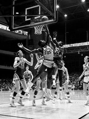 Vanderbilt sophomore Perry Wallace (25) battles North Carolina teammates Rusty Clark (43) and Charlie Scott (33) for the rebound. Vanderbilt won its third straight game of the young season 89-76 over the Tar Heels before a crowd of 11,200 at Memorial Gym on Dec. 9, 1967.