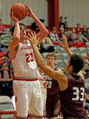 Holliday's Brayden Wyatt shoots over Bowie's Daniel Mosley Friday, Jan. 5, 2018, in Holliday. The Eagles defeated the Jackrabbits 46-43.