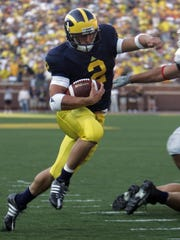 Michigan running back Sam McGuffie runs past Utah's Koa Misi for a touchdown at Michigan Stadium on Saturday, Aug. 30, 2008. U-M lost, 25-23.