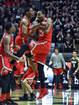 Keita Bates-Diop of Ohio State jumps into the arms of his teammates after hitting the winning shot as the Buckeyes upset Purdue 64-63 Wednesday, February 7, 2018, at Mackey Arena.