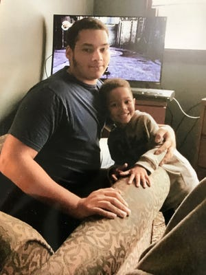 Adam Trammell (left) is shown with his nephew in this family photo. Trammell was 22 when he died after being Tased by West Milwaukee police in May.