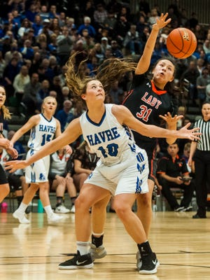 Havre's Kyndall Keller defends while Hardin's Bergan Realbird reaches for the ball during the Class A girls' championship game at Four Seasons Arena Saturday.